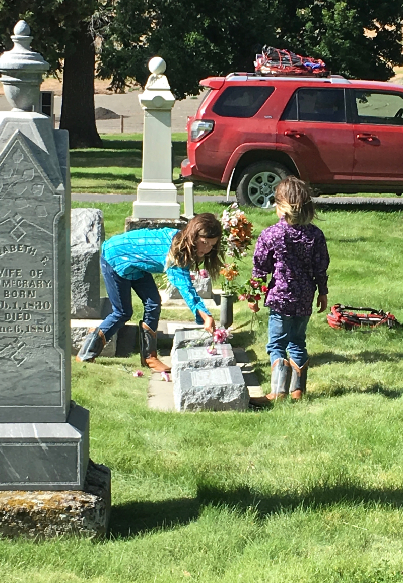 Sofie and Lara Putting Flowers on the Family Graves